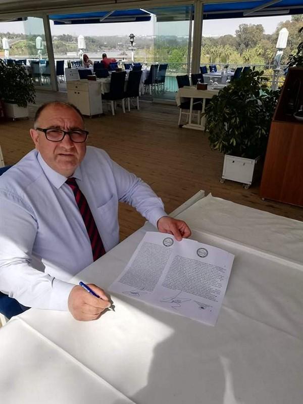 Başkanı Derviş Göçmen arasında bir anlaşma protokolü imzaladı.